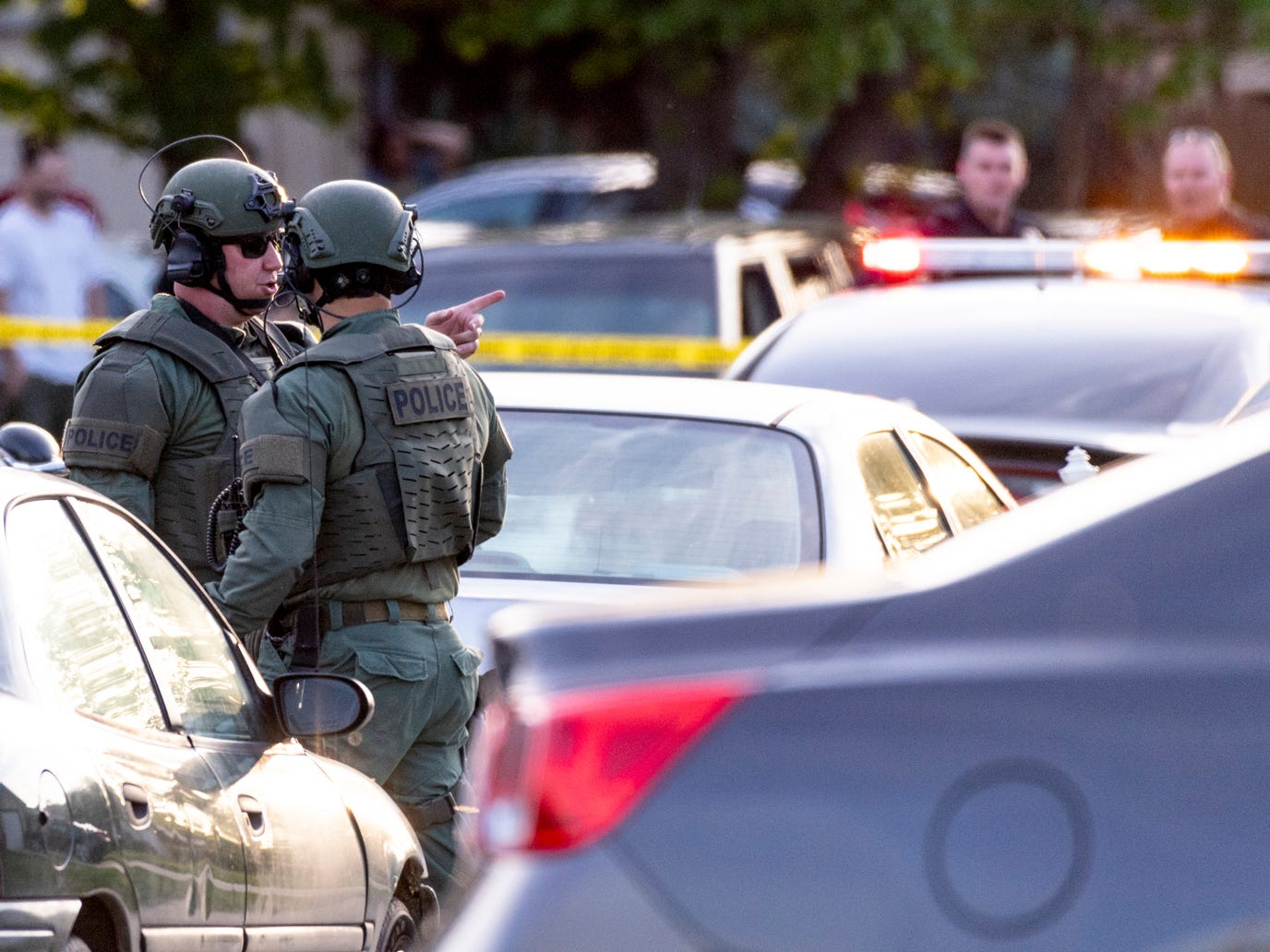 Visalia police gather in the 2000 block of East Hillcrest Avenue after a domestic disturbance turned into a hostage situation on Sunday, April 7, 2019.