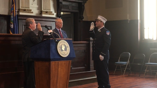 Yonkers Mayor Mike Spano swears in the city's newest fire captain, Joseph Pinto, at a City Hall ceremony April 8, 2019, as Fire Commissioner Robert Sweeney looks on