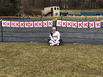 Mahopac sophomore Shannon Becker poses in front her 19 strikeout signs after a no-hitter against Scarsdale. Apr. 2, 2019.