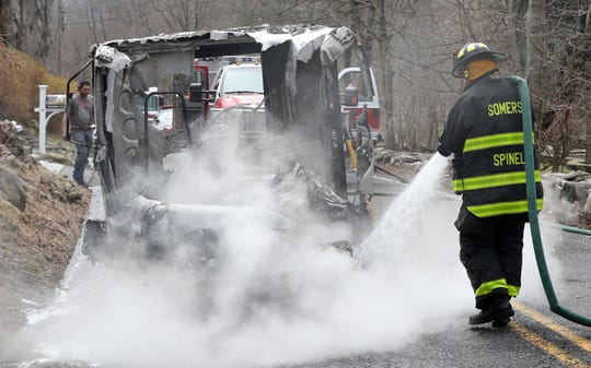 Somers firefighters extinguish a fire that destroyed a U.S. Postal Service mail truck in front of 108 Warren Street in Somers April 8, 2019. The mail carrier was uninjured and able to salvage some of the items from the vehicle.
