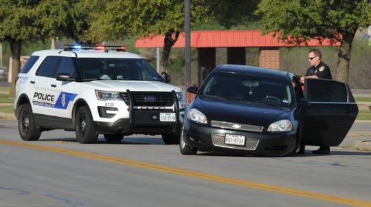 Wichita Falls police work the scene of an alleged stolen vehicle crash Monday morning.