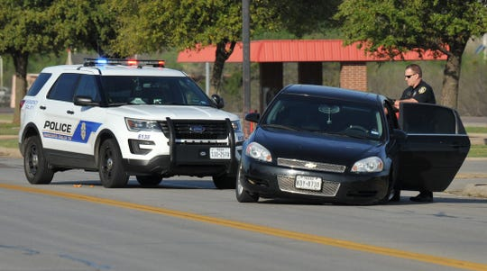 Wichita Falls police work the scene of an alleged stolen vehicle crash Monday morning.