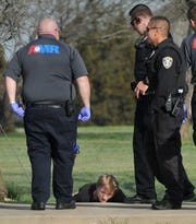 Wichita Falls police detain a possible suspect, Monday morning, near the 4500 block of Seymour Hwy., after he allegedly stole a car and lead police on a pursuit.
