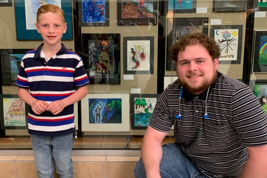 Artists Brody Riley and senior MSU Fine Arts major Collin Bachman with their works at the Art Relay Gallery exhibition in Sikes Senter Mall