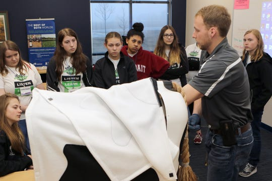 David Verhoef, with Lakeshore Technical College, explains artificial insemination using a Bovine Breeder during the Professional Dairy Producers of Wisconsin Youth Leadership Derby on April 6.