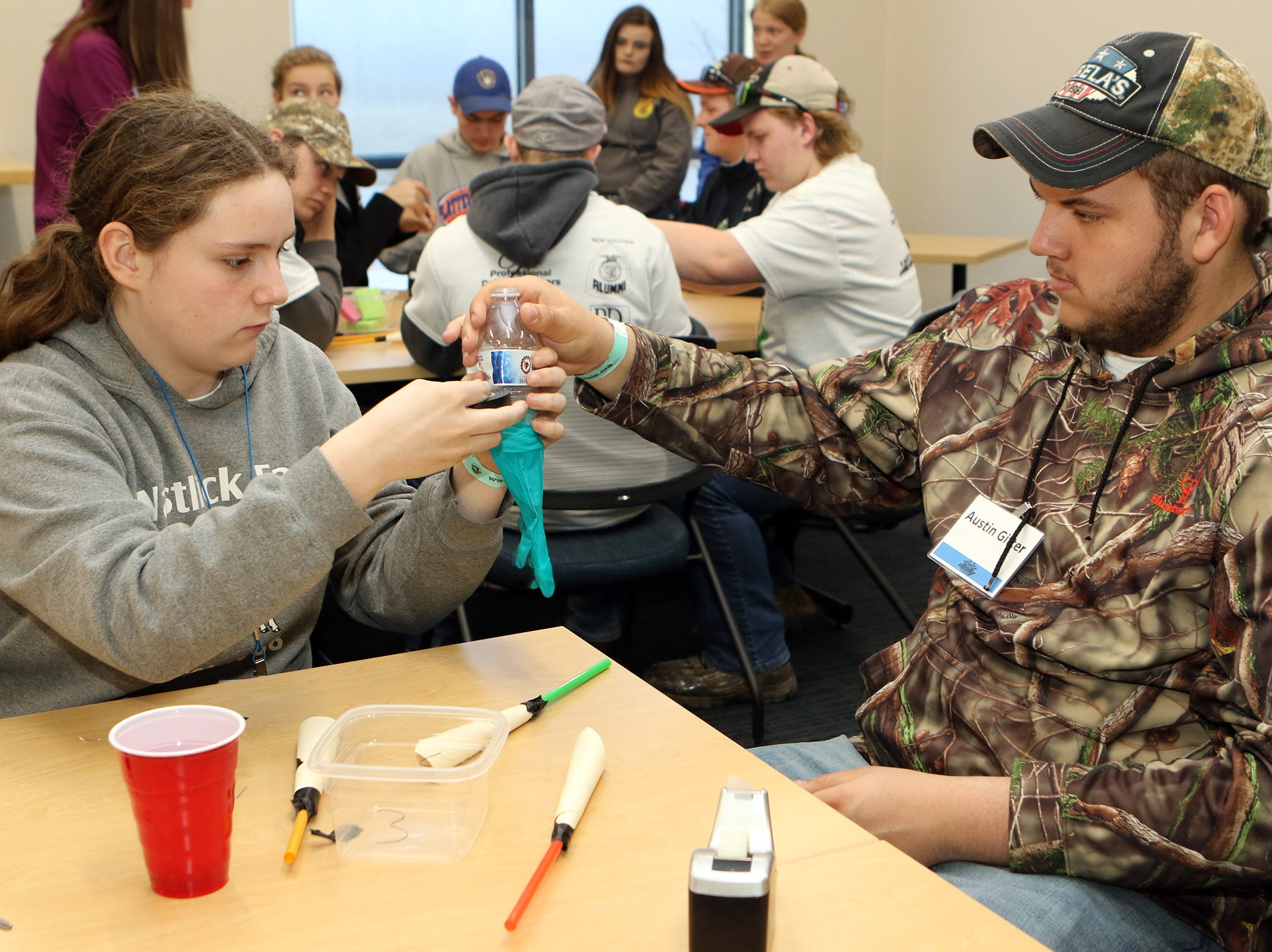 Solena Bodendein, of Wonewoc, and Austin Gitter, of Oakfield, make a model of a cow's quarter as PDPW Youth Leadership Derby participants learn about the cow's mammary system on April 6 at Lakeshore Technical College.