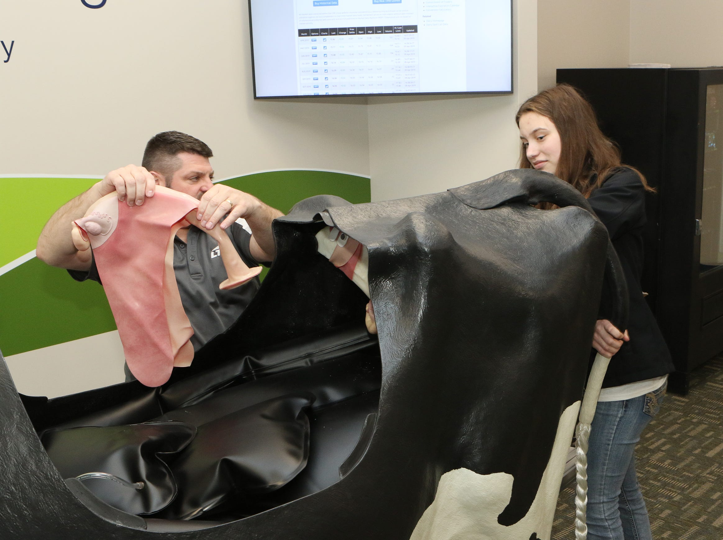 Briana Riesterer, of Kiel, learns about artificial insemination as Craig Lallensack, with Lakeshore Technical College, explains the reproductive tract of cows during the Professional Dairy Producers Youth Leadership Derby on April 6.