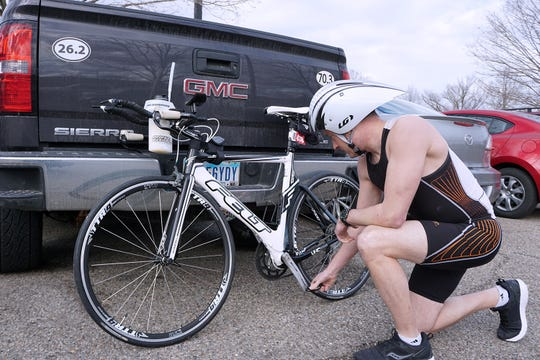 Brad Hollingsworth looks over his bike before taking a training ride in preparation for the Ironman Florida competition in November. He is riding in memory of his training partner, Brenda Hoffman, who was killed four years ago while the two were on a training ride.