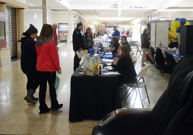 People visit with employers during the Muskingum County Job Fair recently held at the Colony Square Mall.