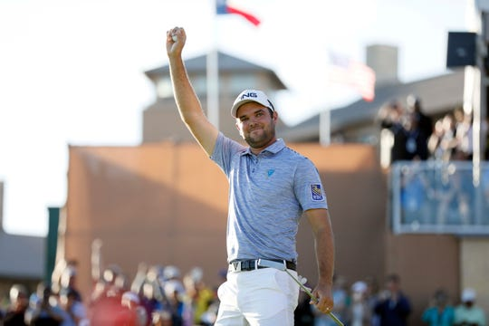 Corey Conners celebrates after winning the Valero Texas Open on Sunday for his first PGA Tour victory.