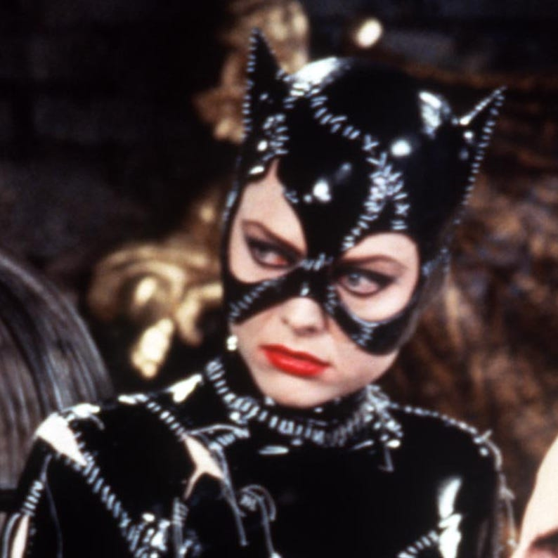 "Michelle Pfeiffer as Catwoman and Danny DeVito as Penguin in ""Batman Returns."""