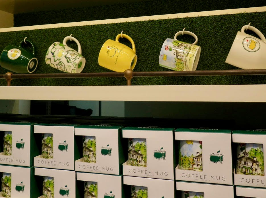"""Masters mugs: $15 – Mugs are surging high up the list of most popular items. Crafted to survive dishwashers and drops, and the variety of options was expanded with a new floral print mug along with a set featuring """"Augusta National Golf Club"""" embossed below the Masters logo."""