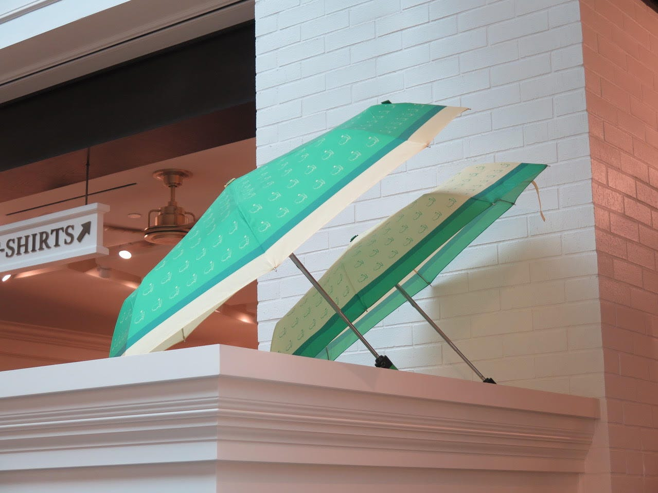 Umbrella – The iconic Masters umbrella –complete with a golf grip – is still available but this handy smaller pop-up in the women's section can be used by all. Sporting a green faux-leather handle this is a much more convenient way to stave off the rain.