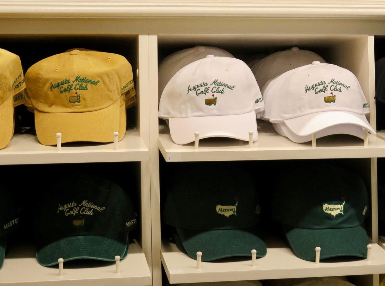 """ANCG Logo Hat: $26-$32 – The 1934 collection once relegated to exclusive shops has expanded again to the main Golf Shop, and with that a huge break from 21st century tradition of rarely selling gear that mentions """"Augusta National Golf Club."""" These hats featuring ANGC and the older logo seen on member green coats adds a new dimension to the hat game."""