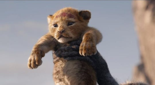 "Simba (voiced by Donald Glover) in the live-action ""The Lion King."""
