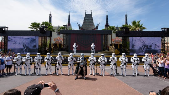 Stormtroopers march at Disney's Hollywood Studios. The foot soldiers famously linked to the evil Galactic Empire will be on hand at Disneyland's new Star Wars-themed land to keep visitors from lingering too long.