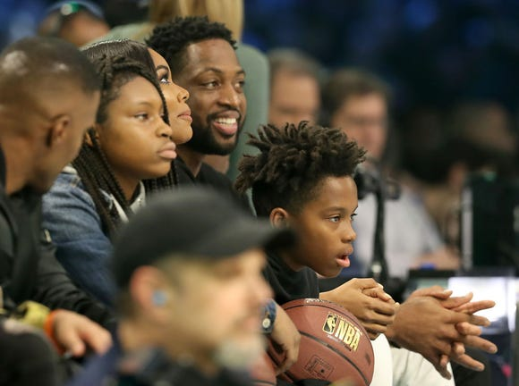 Dwayne Wade, Gabrielle Union-Wade and family watch play during the MTN DEW 3-Point Contest as part of the 2019 NBA All-Star Weekend at Spectrum Center on February 16, 2019 in Charlotte, North Carolina.