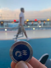 Showing the OceanMedallion on deck at dusk.