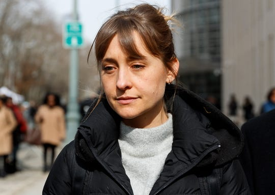 Actress Allison Mack departs federal court after a hearing in the case against her in which she accused of helping to run an alleged sex cult in Brooklyn, New York, February 6, 2019.