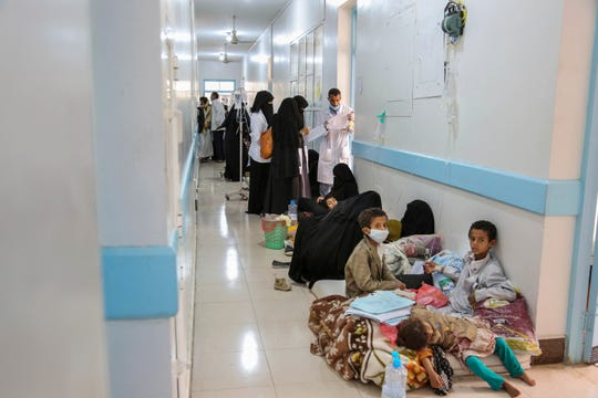 In this May 12, 2017 photo released by UNICEF, patients suffering from severe diarrhea and suspected of cholera, wait to receive treatment, at a hospital in Sanaa, Yemen. An Associated Press investigation finds the massive cholera epidemic was aggravated by corruption and official intransigence. The investigation has found that both the Iranian-backed Houthis rebels and their main adversary in the war -- the U.S.- and Saudi-backed government that controls southern Yemen -- impeded efforts by relief groups to stem the epidemic.