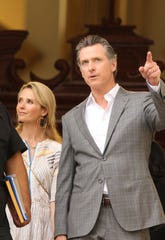 California Gov. Gavin Newsom, and his wife, Jennifer Siebel Newsom walk together after visiting the tomb of Archbishop Oscar Romero at Metropolitan Cathedral in San Salvador, El Salvador, Sunday, April 7, 2019.