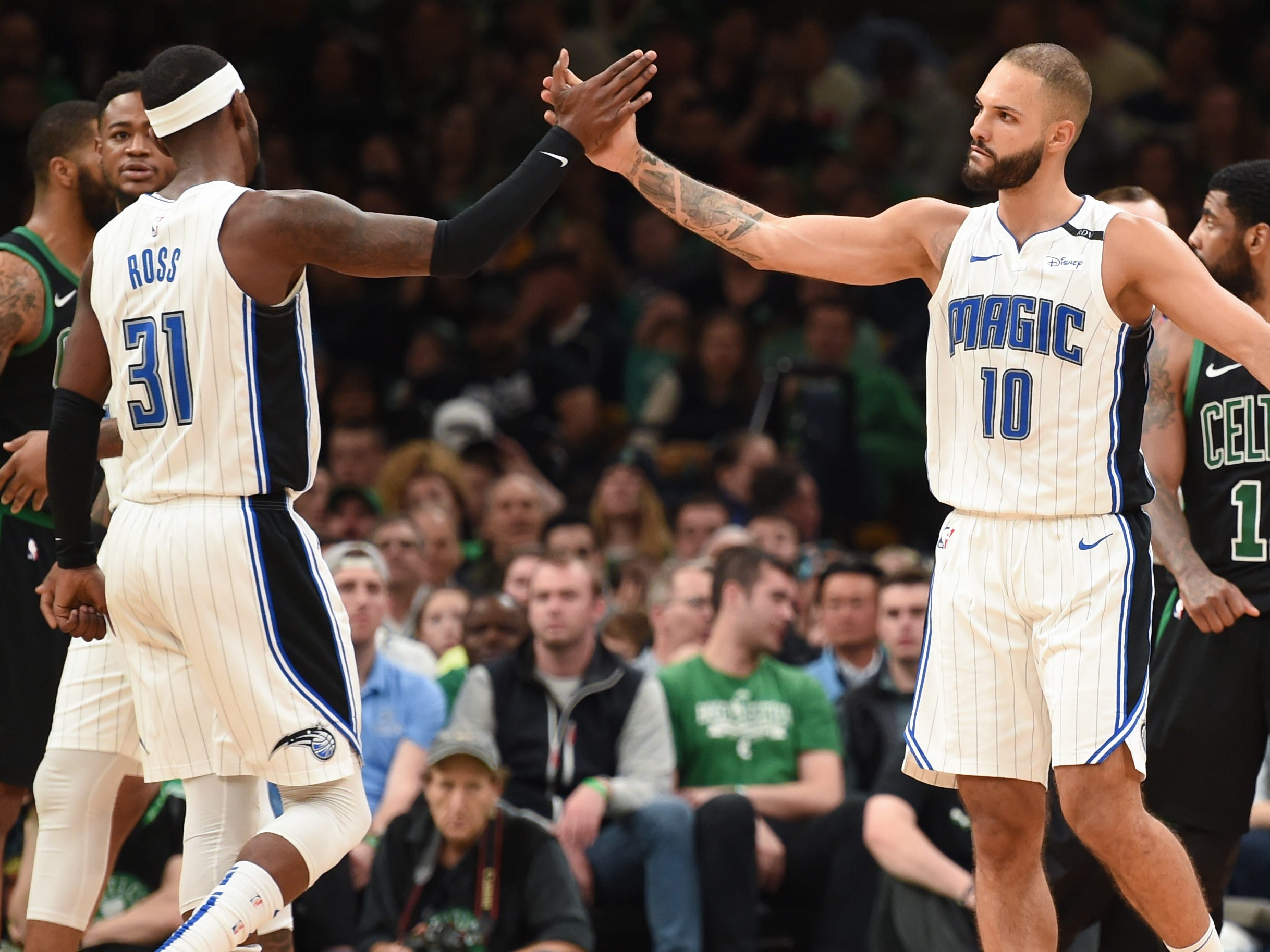 April 7: Terrence Ross (31) and Evan Fournier (10) celebrate a big second-half bucket in the Magic's playoff-clinching win over the Celtics in Boston.