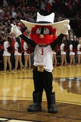 "Texas Tech's  mascot shows the ""guns up"" signal at a game this season."
