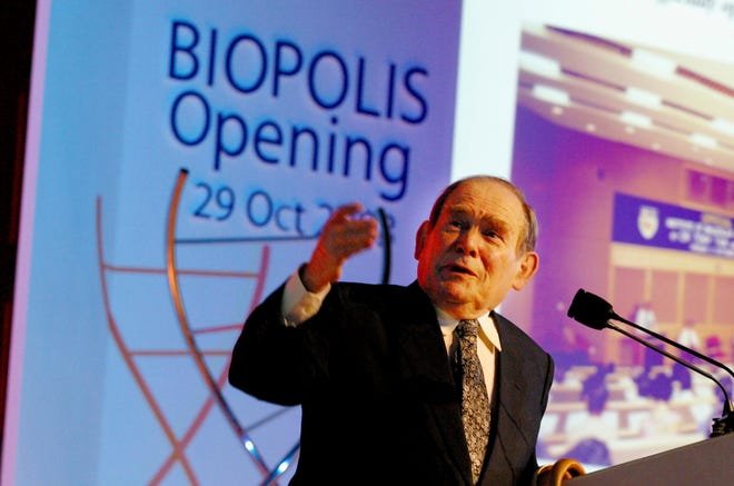 In this Oct. 29, 2003, file photo, Nobel laureate Dr. Sydney Brenner of the Salk Institute for Biological Studies in San Diego, Calif., gives a lecture at the opening of Biopolis in Singapore.