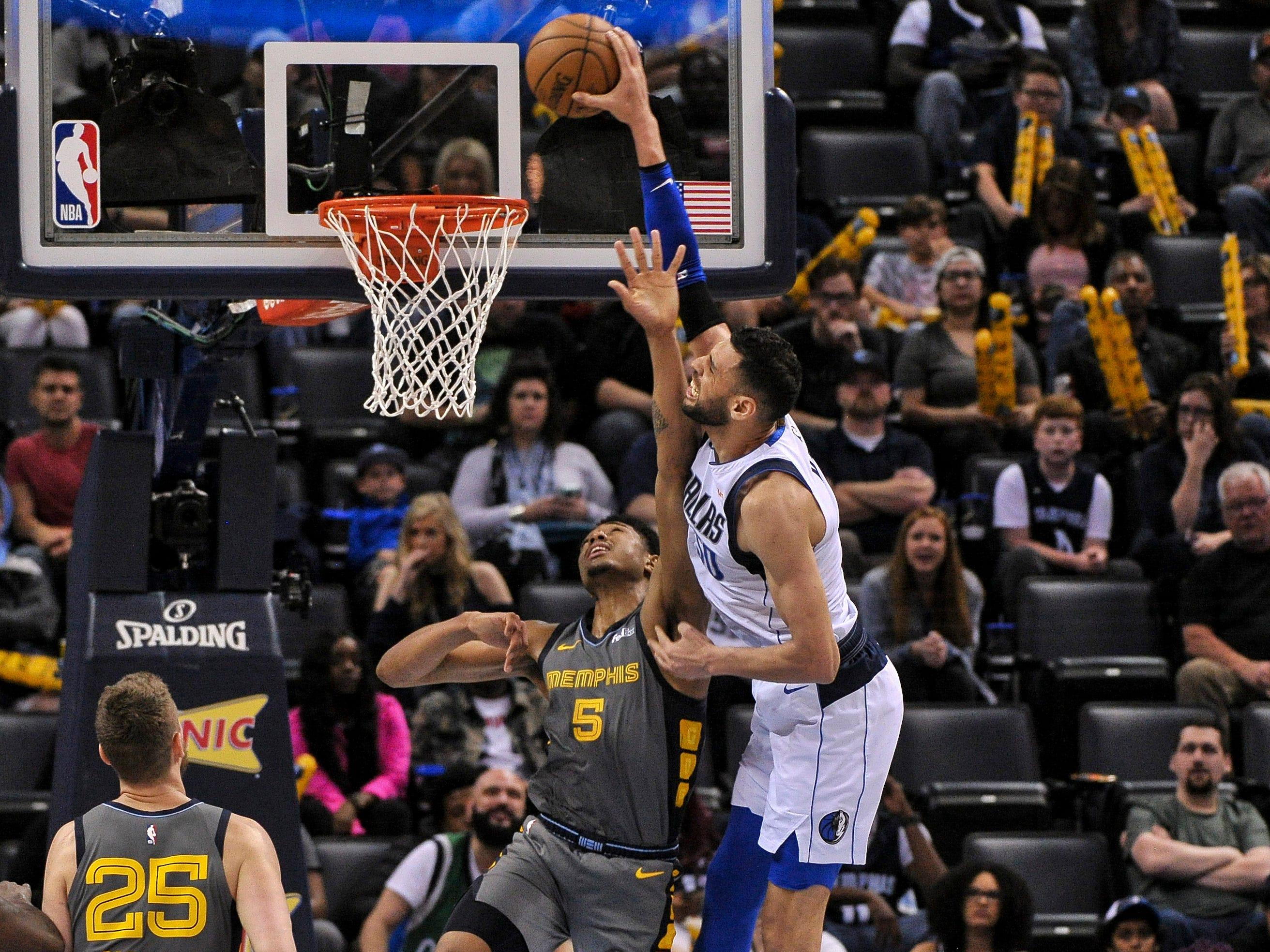 April 7: Mavericks center Salah Mejri (50) puts Grizzlies defender Bruno Caboclo (5) on a poster with the monster one-handed slam.