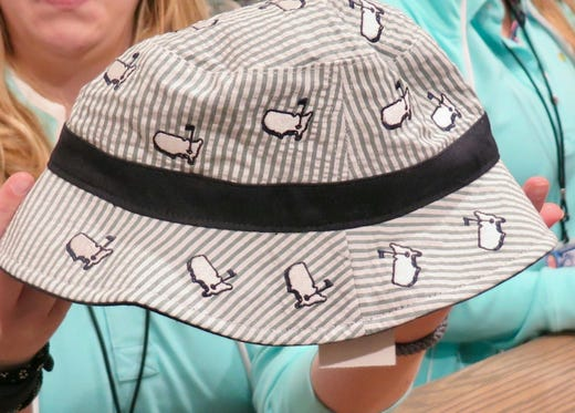 0a9012ea965c9 Reversible Bucket Cap   30 – Moms are going to love this reversible  seersucker bucket cap