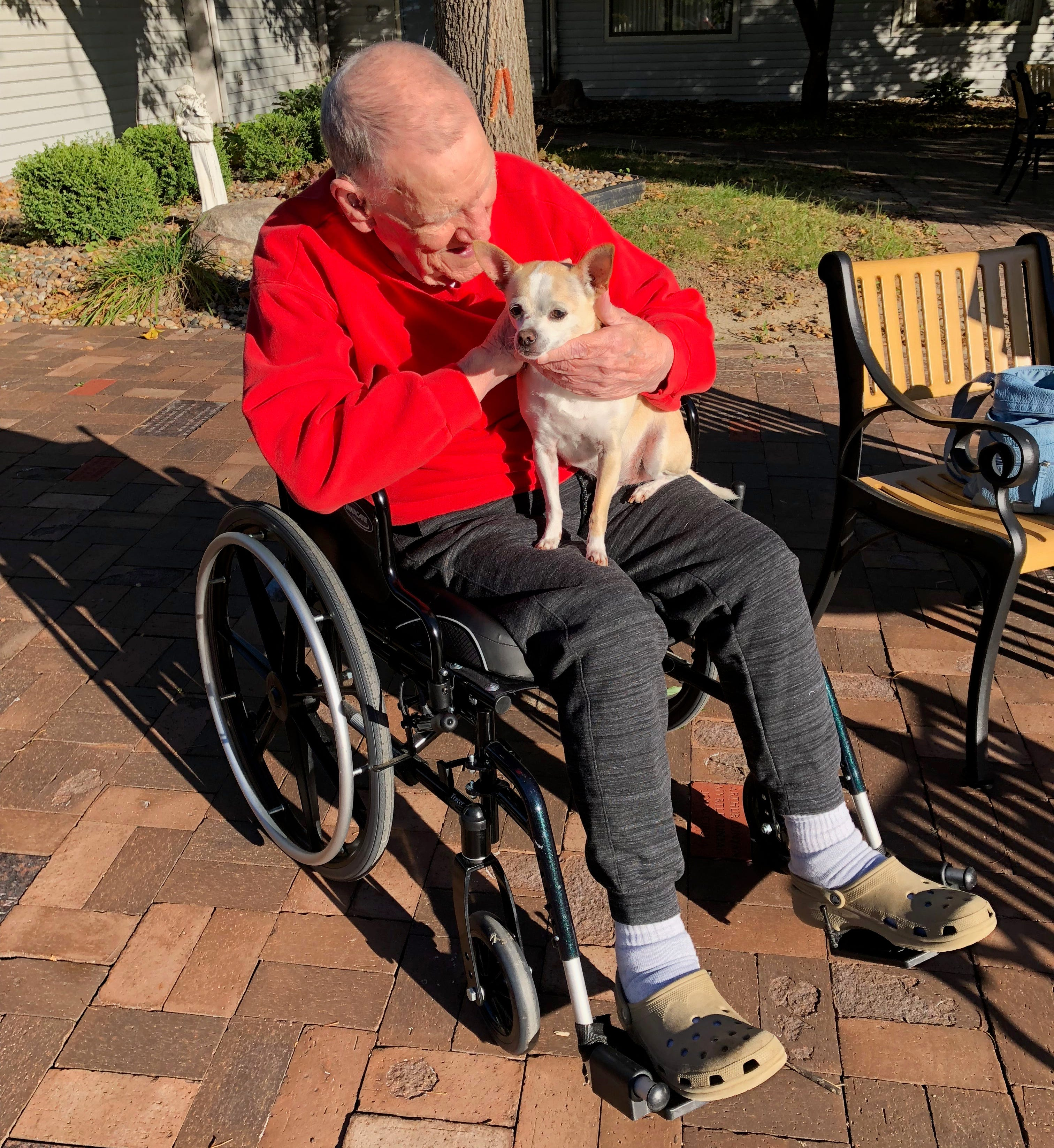 "This is James ""Milt"" Ferguson Sr. with his dog Macaroni. He was 91 years old, a veteran of World War II and died from a head injury he received in the Veterans Affairs nursing home in Des Moines."