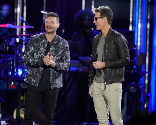Ryan Seacrest, left, and Bobby Bones