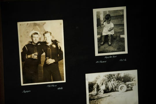 "A family album shows a photo of James ""Milt"" Ferguson Sr., second from right, during his days in the Navy."