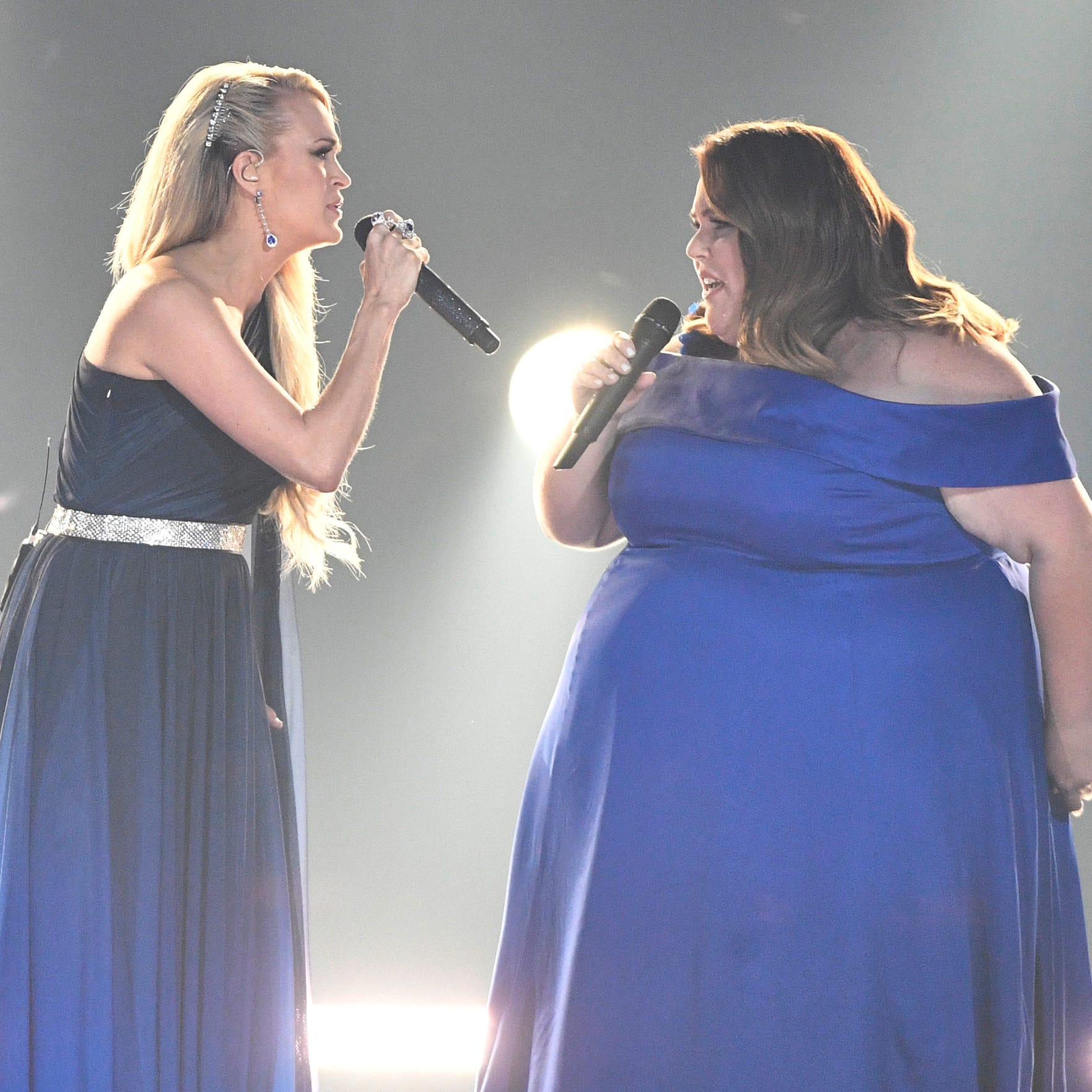 Carrie Underwood, left, and Chrissy Metz, perform during the 54TH Academy of Country Music Awards Sunday, April 7, 2019, in Las Vegas, Nev.  ORG XMIT: TNNAT (Via OlyDrop)
