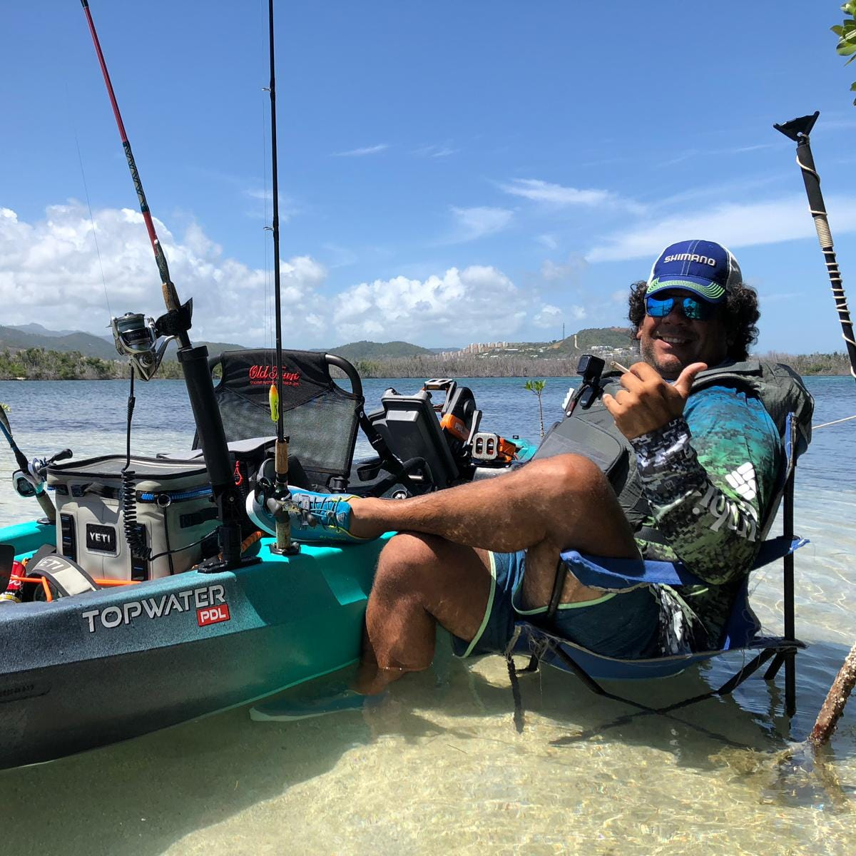 Capt. Jose Aponte enjoys a break in the fishing action.