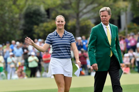 Jennifer Kupcho walks with Augusta National chairman Fred Ridley after winning the inaugural Augusta National Women's Amateur golf tournament.