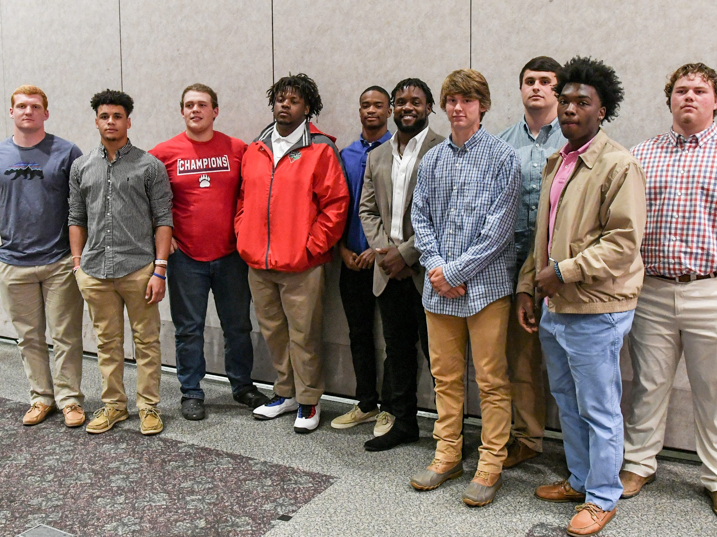 Belton-Honea Path High School players gather for a photo with former Bear linebacker Kendall Joseph, middle, during the Anderson Area Touchdown Club Annual Awards Banquet at the Anderson County Civic Center Monday, April 8th, 2019. The club and Anderson County Councilman Craig Wooten honored Joseph, who was part of two National Championship Clemson football teams.