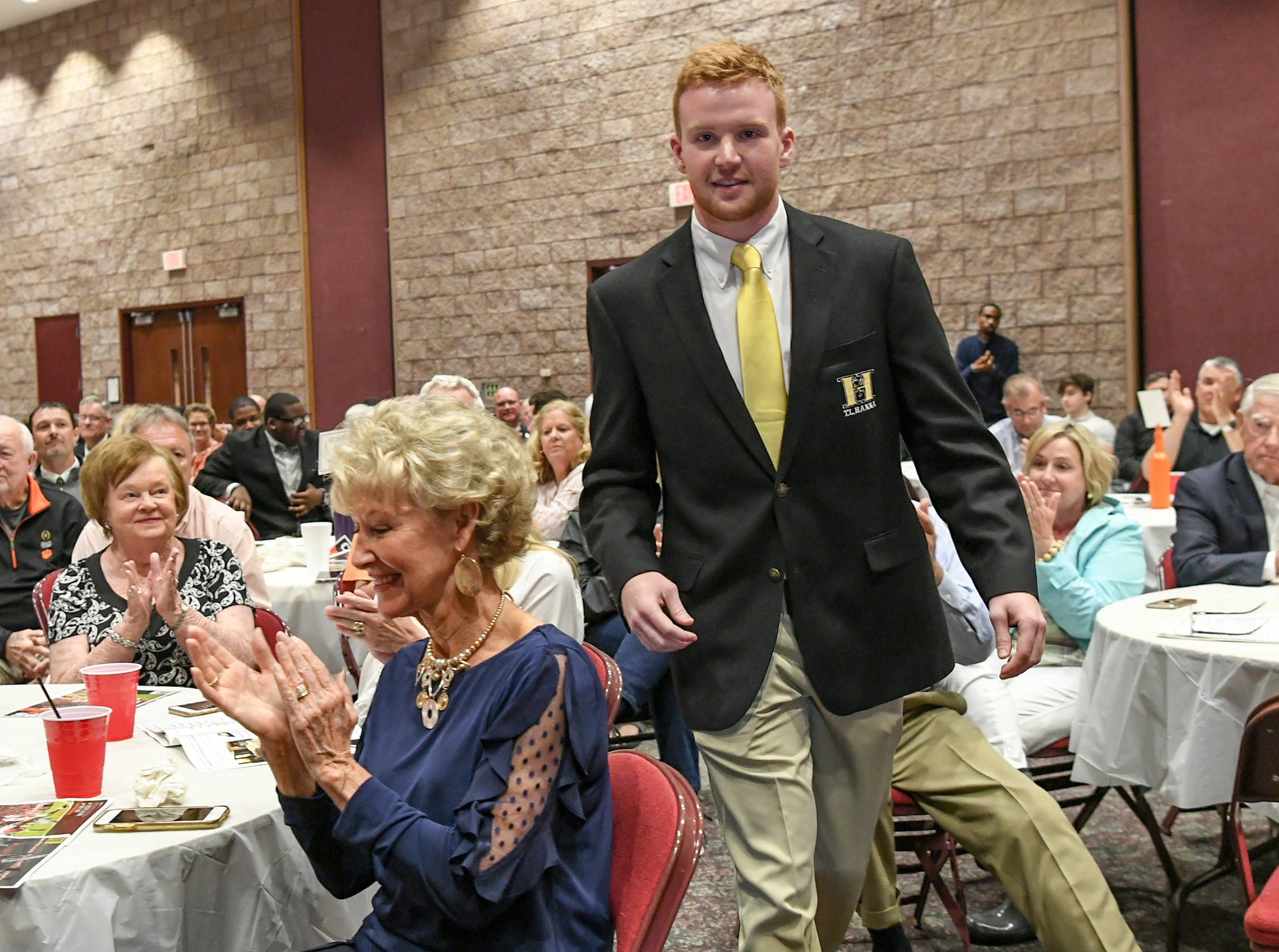 Alex Meredith, former T.L. Hanna High football player accepts the Scholarship Award from Dick Smith during the Anderson Area Touchdown Club Annual Awards Banquet at the Anderson County Civic Center Monday, April 8th, 2019. Awards were given to the Players of the Year and the Coach of the Year from the eight Anderson County high schools. The club honored former Belton-Honea Path player Kendall Joseph who was part of two National Championship Clemson football teams.