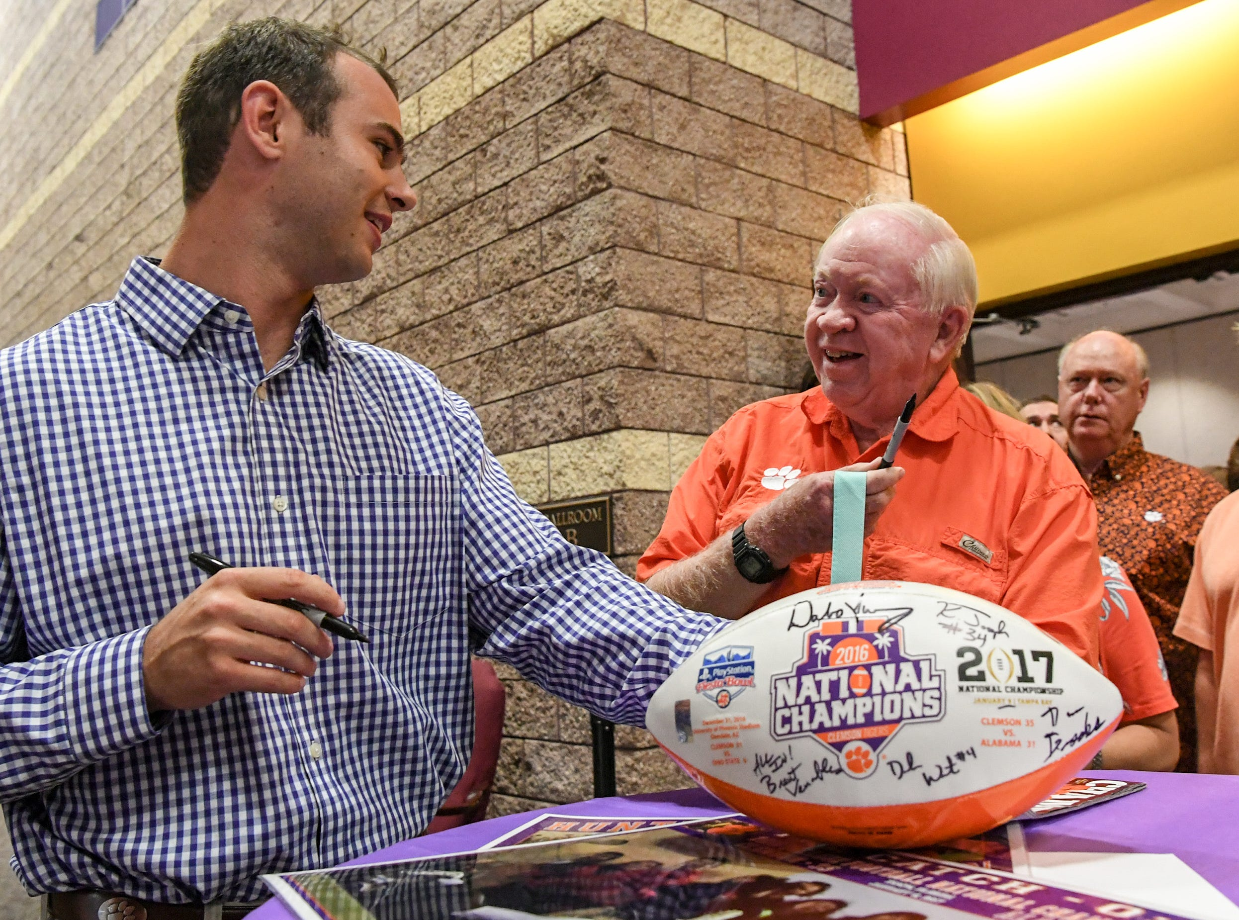 Hunter Renfrow, left, former Clemson football star receiver and two-time national champion, signs an autograph for Ed Ables of Pendleton, before the Anderson Area Touchdown Club Annual Awards Banquet at the Anderson County Civic Center Monday, April 8th, 2019. Awards were given to the high school players of the year, and coach of the year from the eight Anderson County high schools. The club honored former Belton-Honea Path player Kendall Joseph who was part of two National Championship Clemson football teams.