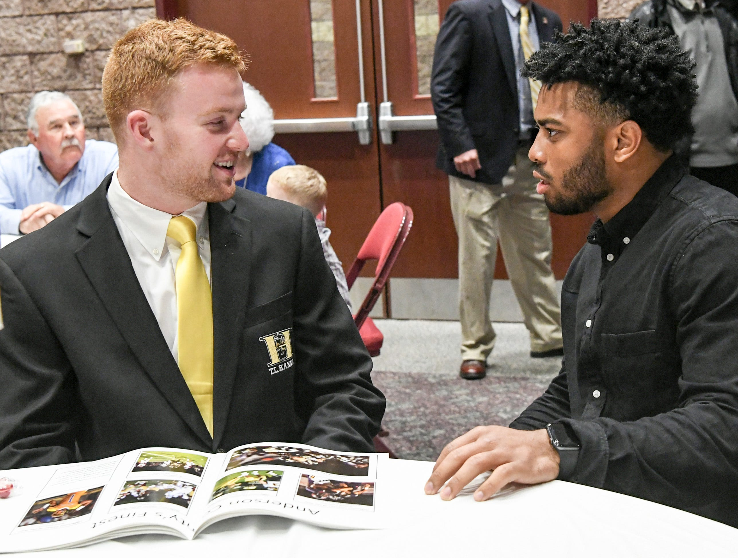 Alex Meredith, left, Scholastic Award winner from T.L.. Hanna High School talks with former Hanna running back and current Clemson running back Darien Rencher, right, before the Anderson Area Touchdown Club Annual Awards Banquet at the Anderson County Civic Center Monday, April 8th, 2019. Awards were given to the Players of the Year and the Coach of the Year from the eight Anderson County high schools. The club honored former Belton-Honea Path player Kendall Joseph who was part of two National Championship Clemson football teams.