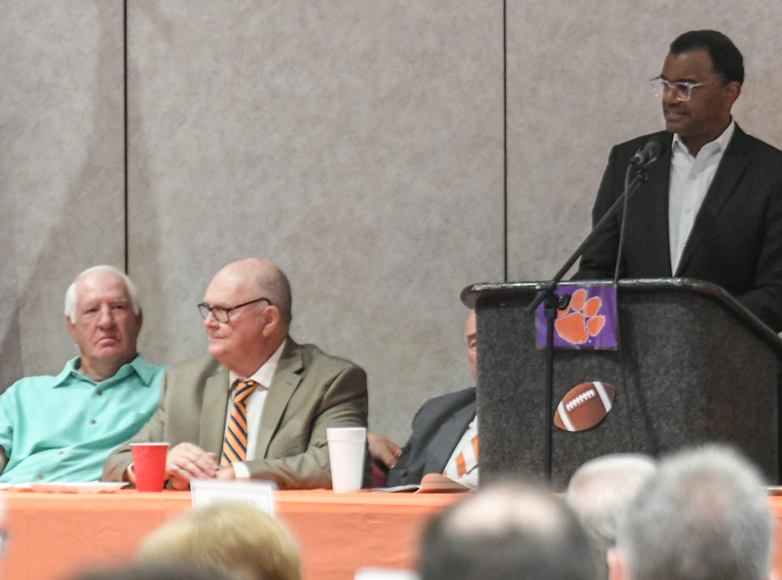 Former Clemson football coach Danny Ford, left, listens to featured speaker Perry Tuttle, right, a former player of his from the 1981 championship season team, during the Anderson Area Touchdown Club Annual Awards Banquet at the Anderson County Civic Center Monday, April 8th, 2019.
