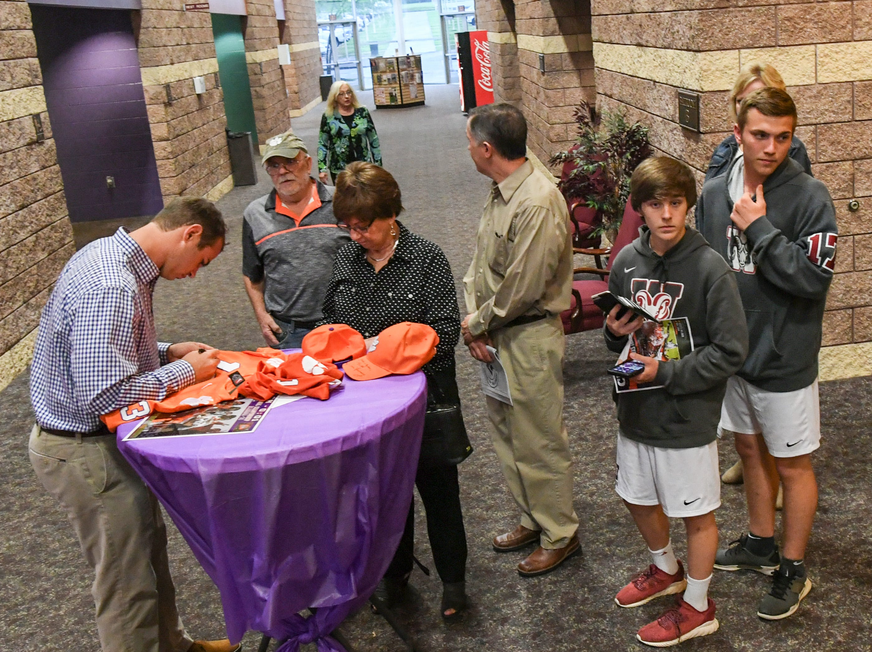 Hunter Renfrow, left, former Clemson football star receiver and two-time national champion, signs autographs for fans before the Anderson Area Touchdown Club Annual Awards Banquet at the Anderson County Civic Center Monday, April 8th, 2019.