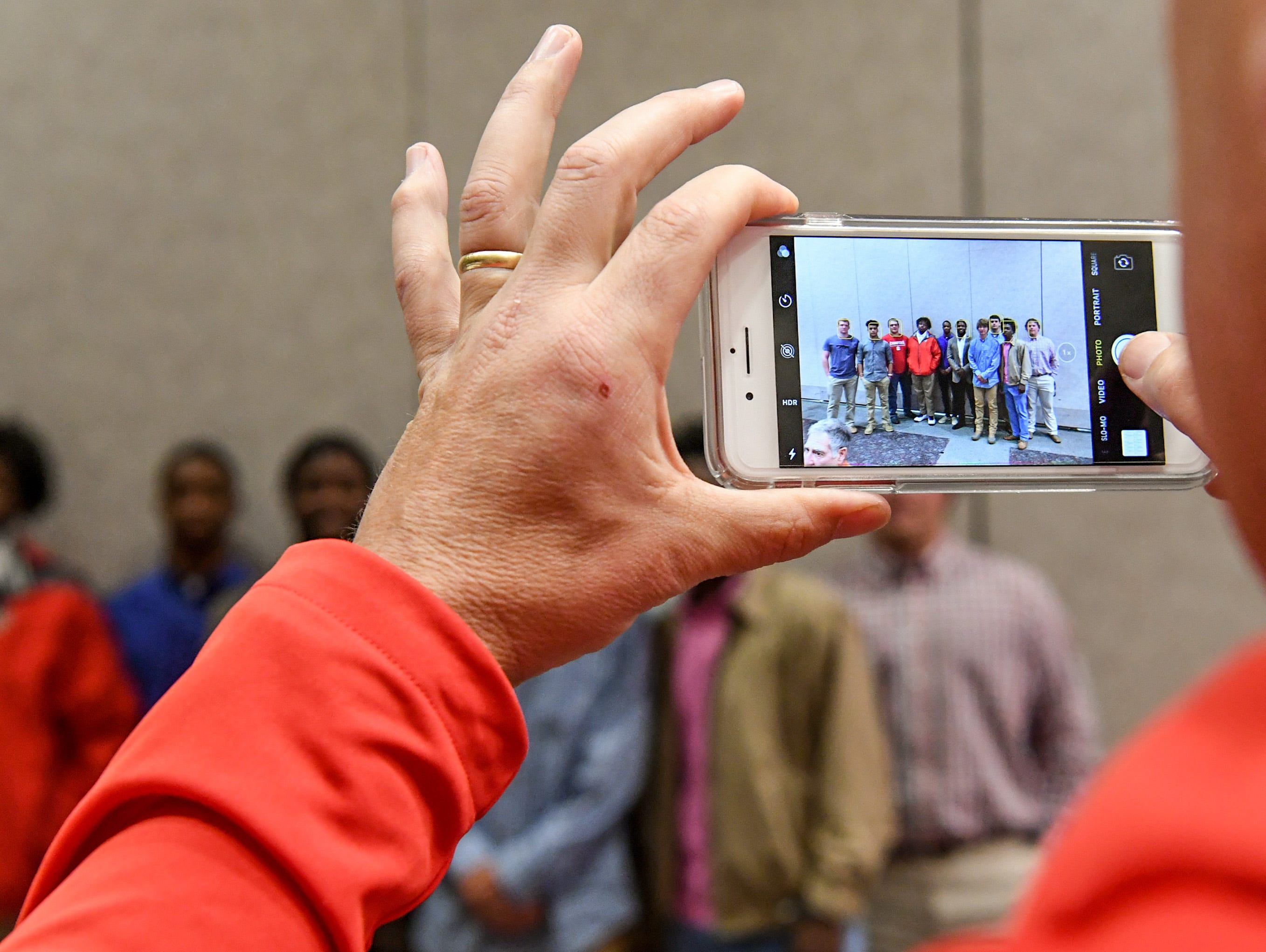 Belton-Honea Path High School coach Russell Blackston takes a photo of players gathering for a photo with former Bear linebacker Kendall Joseph, middle, during the Anderson Area Touchdown Club Annual Awards Banquet at the Anderson County Civic Center Monday, April 8th, 2019. The club and Anderson County Councilman Craig Wooten honored Joseph, who was part of two National Championship Clemson football teams.
