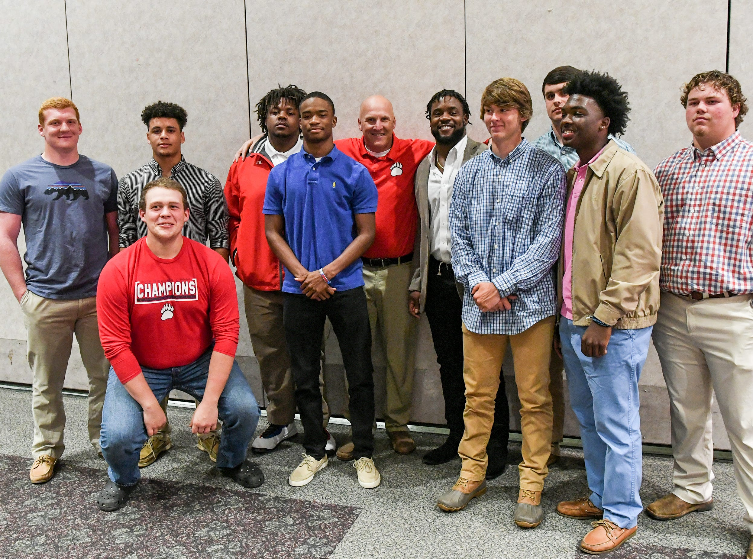 Belton-Honea Path High School coach Russell Blackston poses with players and with former Bear linebacker Kendall Joseph, middle, during the Anderson Area Touchdown Club Annual Awards Banquet at the Anderson County Civic Center Monday, April 8th, 2019. The club and Anderson County Councilman Craig Wooten honored Joseph, who was part of two National Championship Clemson football teams.