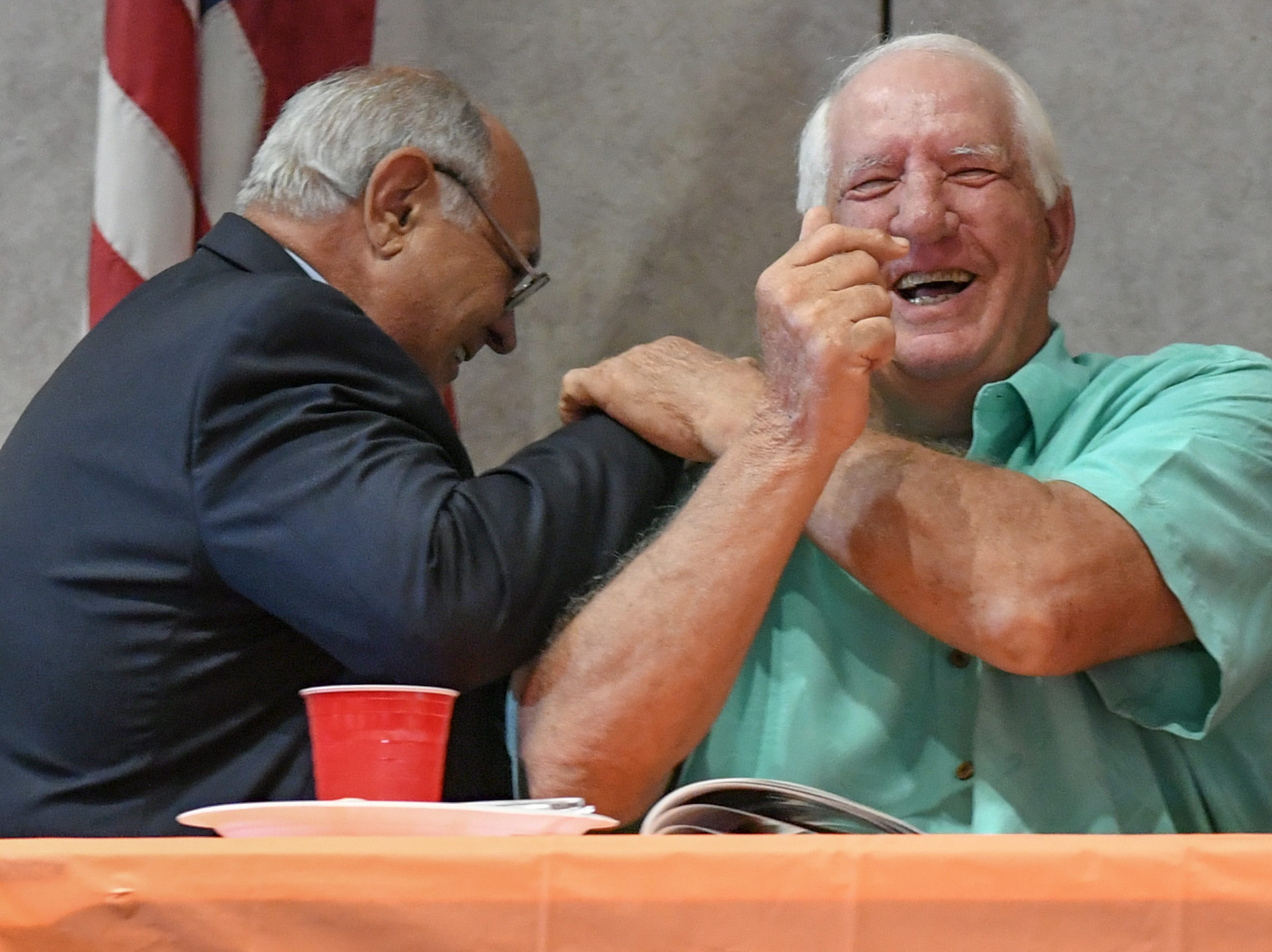Wayne Jones, left, shares a laugh with Danny Ford during the Anderson Area Touchdown Club Annual Awards Banquet at the Anderson County Civic Center Monday, April 8th, 2019. Awards were given to the Players of the Year and the Coach of the Year from the eight Anderson County high schools. The club honored former Belton-Honea Path player Kendall Joseph who was part of two National Championship Clemson football teams.