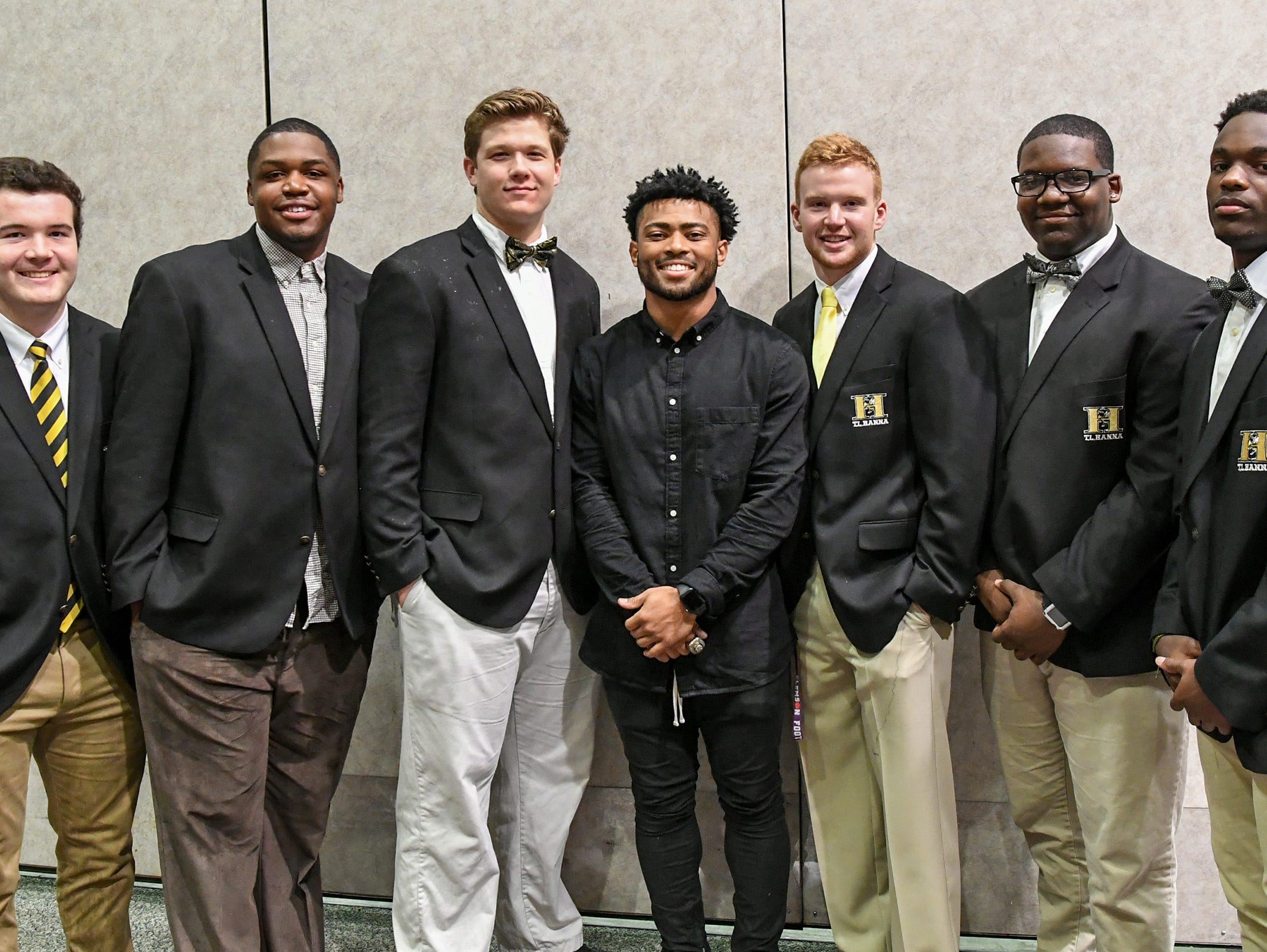 Darien Rencher, middle, former T.L. Hanna High School running back and current Clemson player poses with Hanna players recognized during the Anderson Area Touchdown Club Annual Awards Banquet at the Anderson County Civic Center Monday, April 8th, 2019. The club and county councilman Brett Sanders honored former Yellow Jacket Rencher who was part of two National Championship Clemson football teams, and still has two years of eligibility.