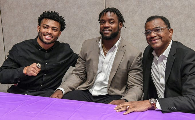 Two-time college football national champions Darien Rencher, left, Clemson running back and former T.L. Hanna star, Kendall Joseph, middle, pose with former Clemson champion season player (1981) Perry Tuttle, right, before the Anderson Area Touchdown Club Annual Awards Banquet at the Anderson County Civic Center Monday, April 8th, 2019.