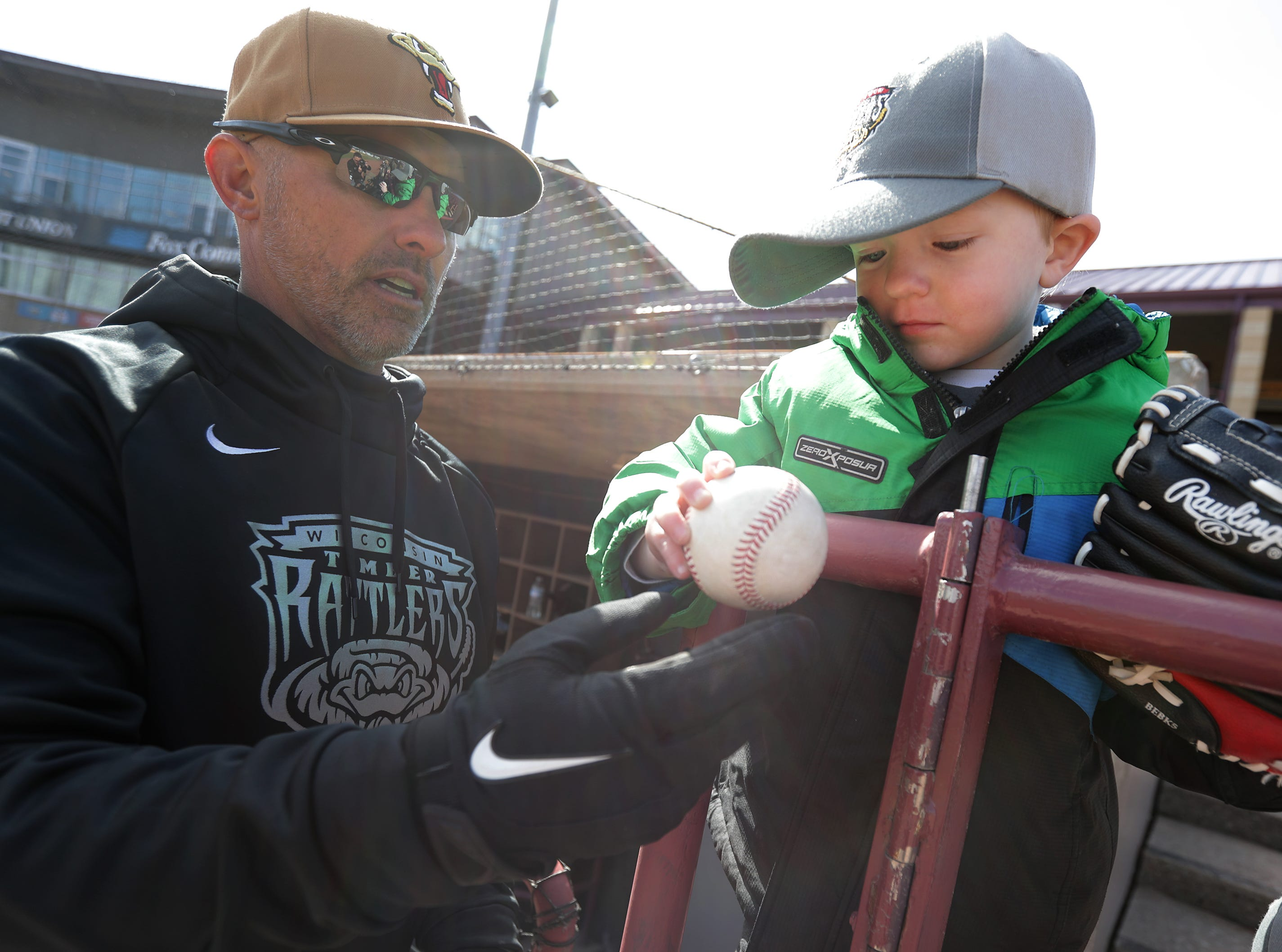 The Wisconsin Timber Rattlers' Manager Matt Erickson gives a ball to Connor Lenz during Fan Fest at Neuroscience Group Field at Fox Cities Stadium on Tuesday, April 2, 2019, in Grand Chute, Wis.Wm. Glasheen/USA TODAY NETWORK-Wisconsin.