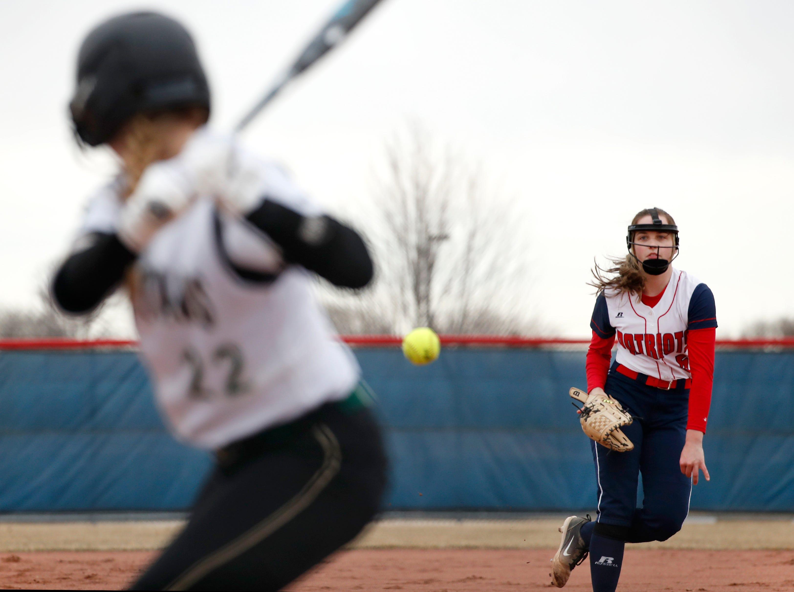 Appleton East High SchoolÕs Gwen Hendrick pitches at Oshkosh North High SchoolÕs Brooke Ellestad Thursday, April 4, 2019, in Appleton, Wis. Danny Damiani/USA TODAY NETWORK-Wisconsin