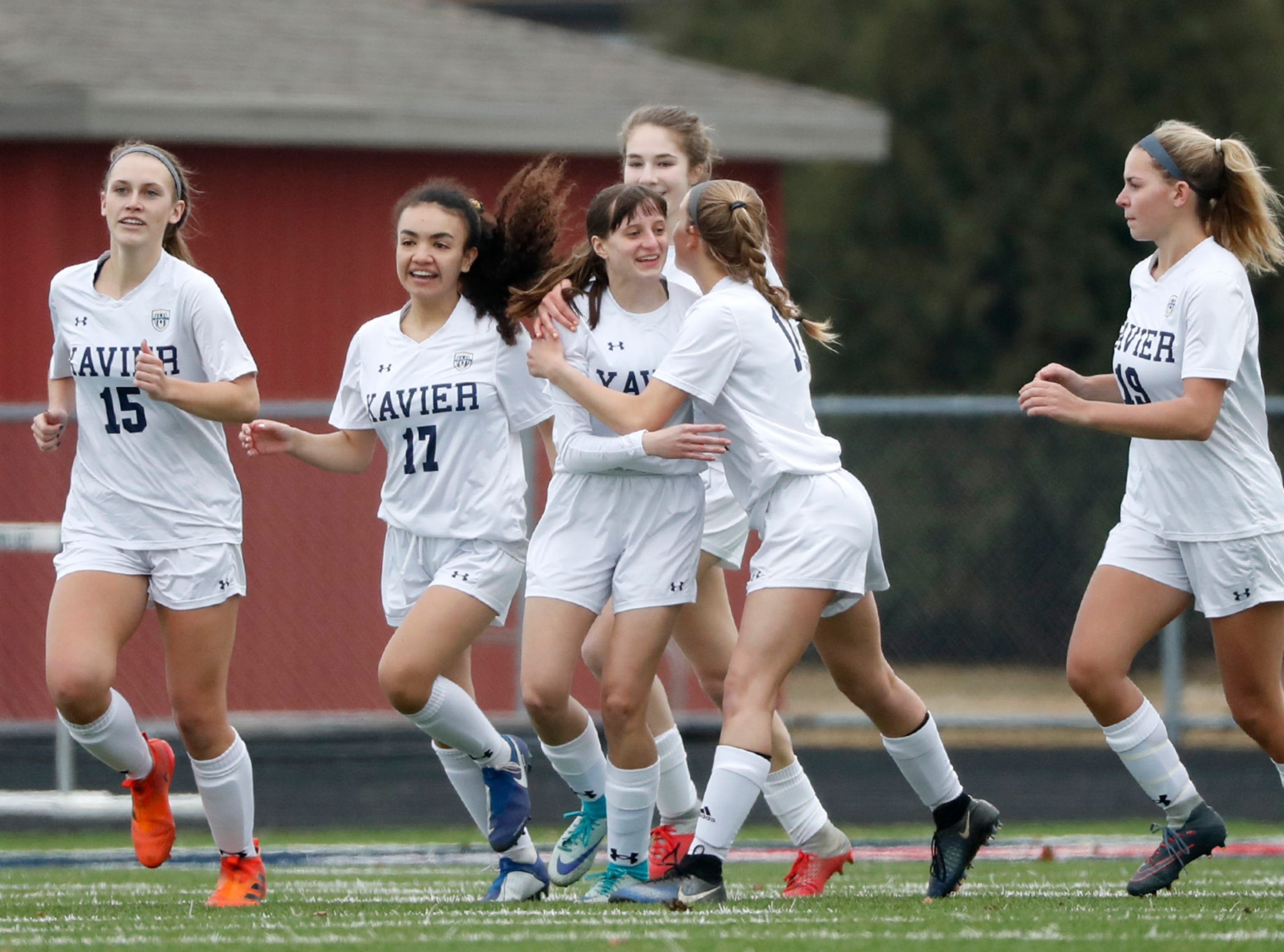 Xavier High School's Alli Matzek (center) celebrates with teammates after scoring against Appleton East High School Friday, April 5, 2019, in Appleton, Wis. Danny Damiani/USA TODAY NETWORK-Wisconsin
